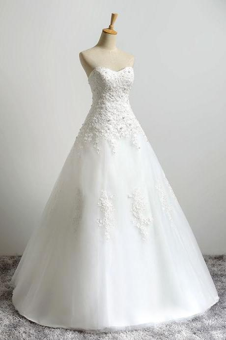 Ivory Lace Appliqués Tulle Wedding Gown Showcases Beaded Floral Lace Bodice and Lace-Up Back